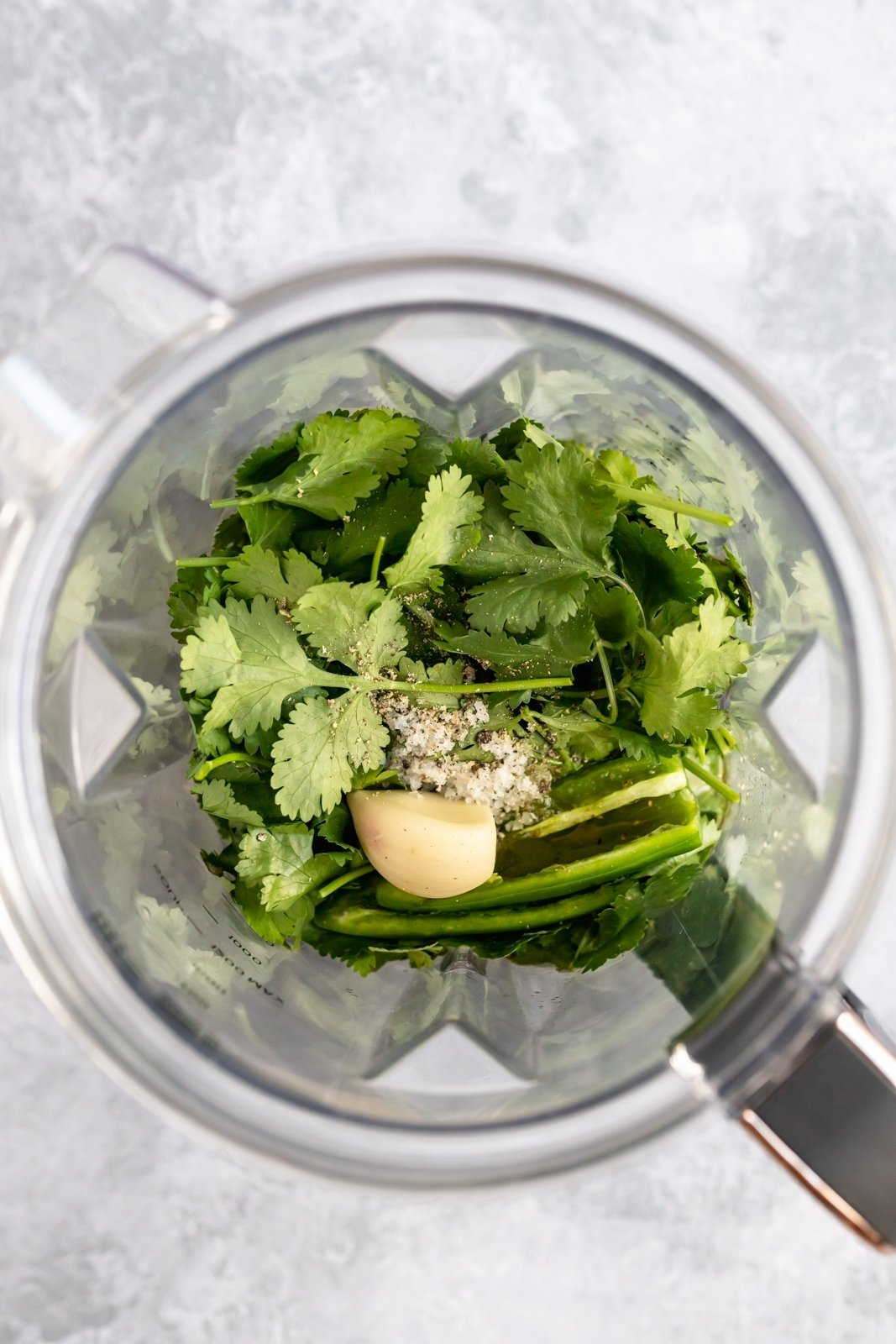 ingredients for cilantro lime dressing in a blender