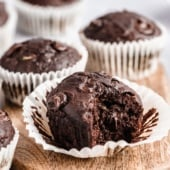healthy chocolate zucchini muffin with a bite taken out