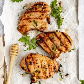 honey mustard marinated chicken on parchment paper