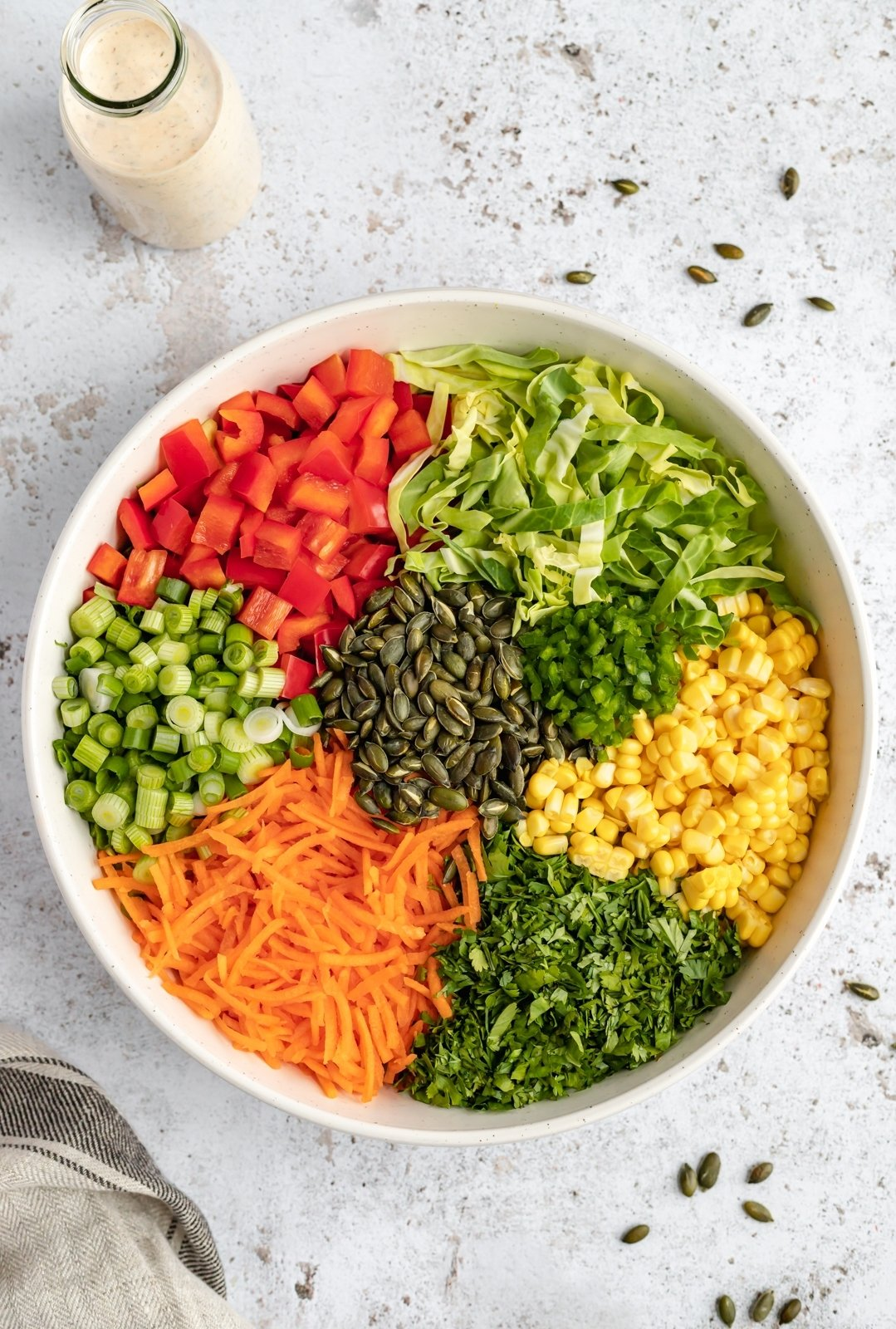 ingredients for healthy chopped chicken salad in a bowl