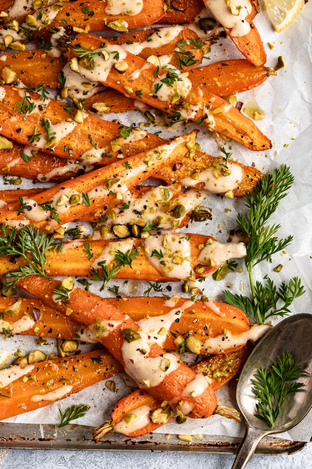roasted carrots drizzled with creamy tahini sauce