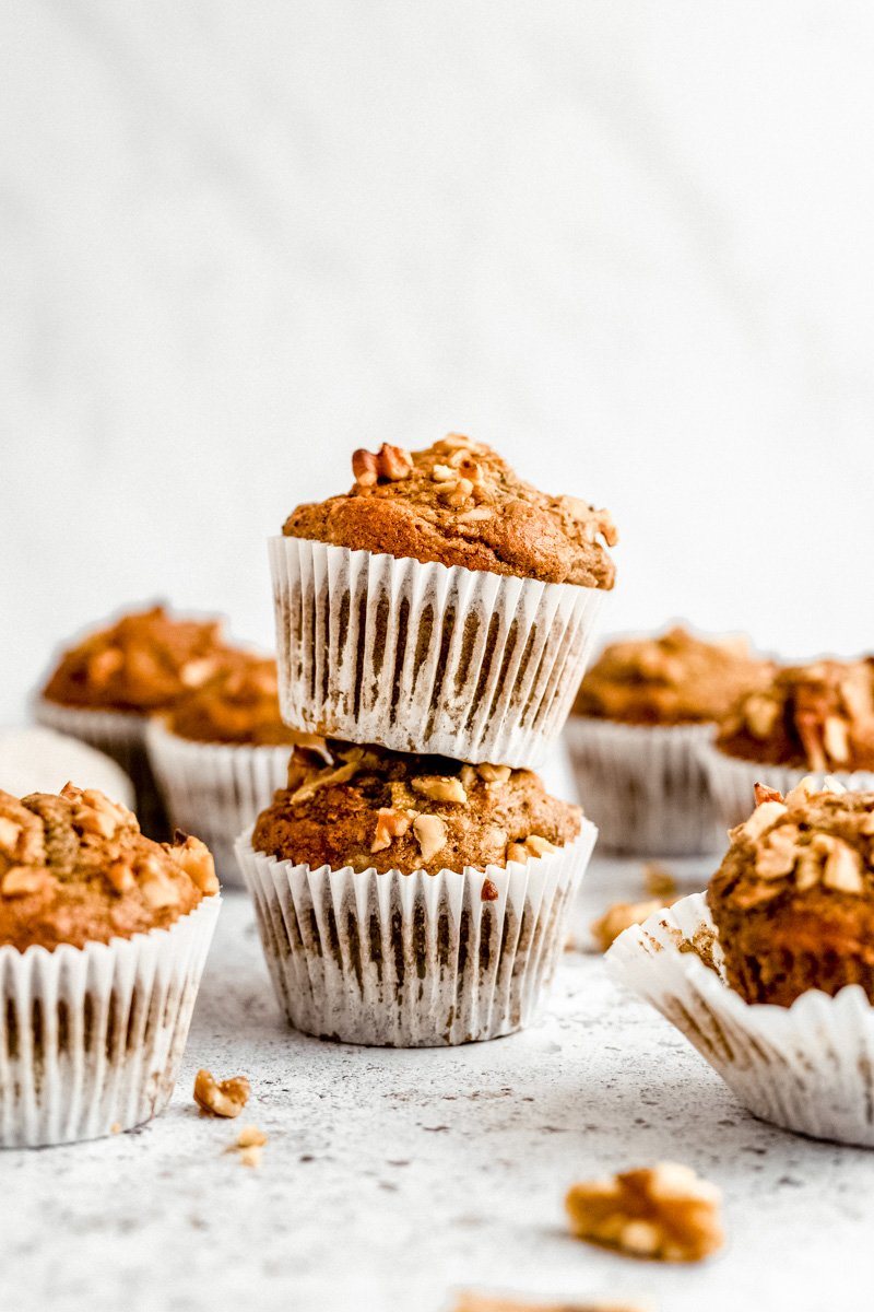 two healthy banana muffins in a stack