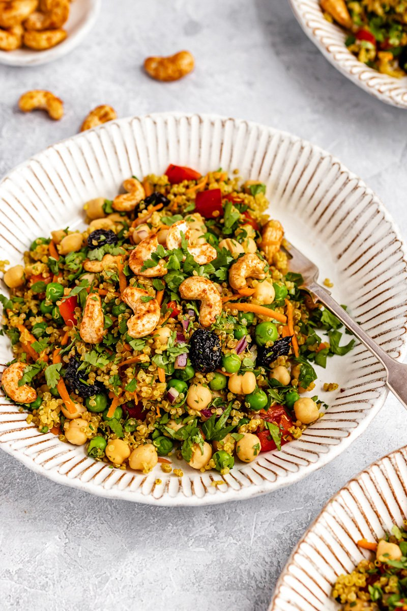 vibrant chickpea quinoa salad in a bowl with a fork