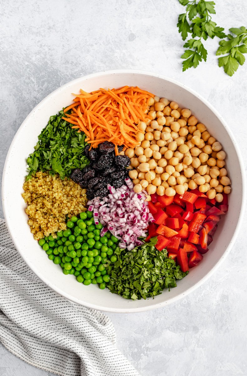 vibrant curry cashew quinoa salad in a large bowl