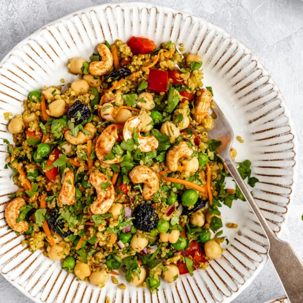 vibrant curry chickpea quinoa salad on a plate