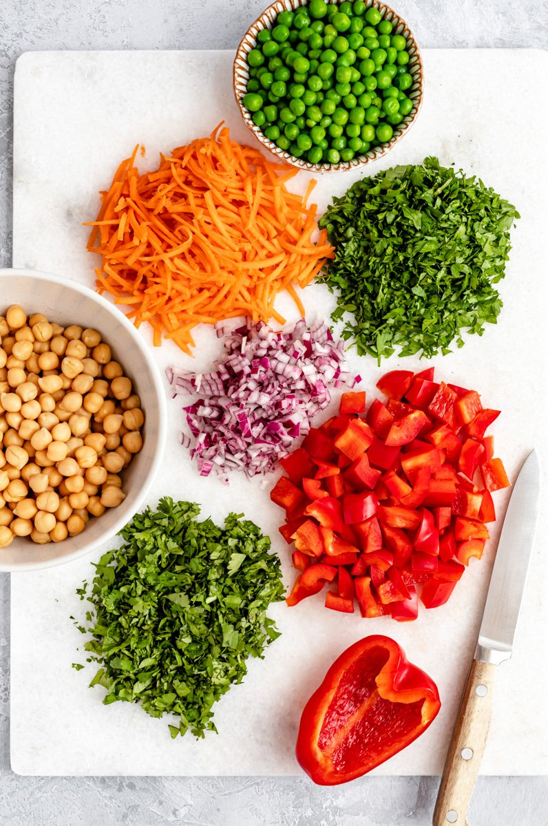 curry quinoa salad ingredients on a cutting board