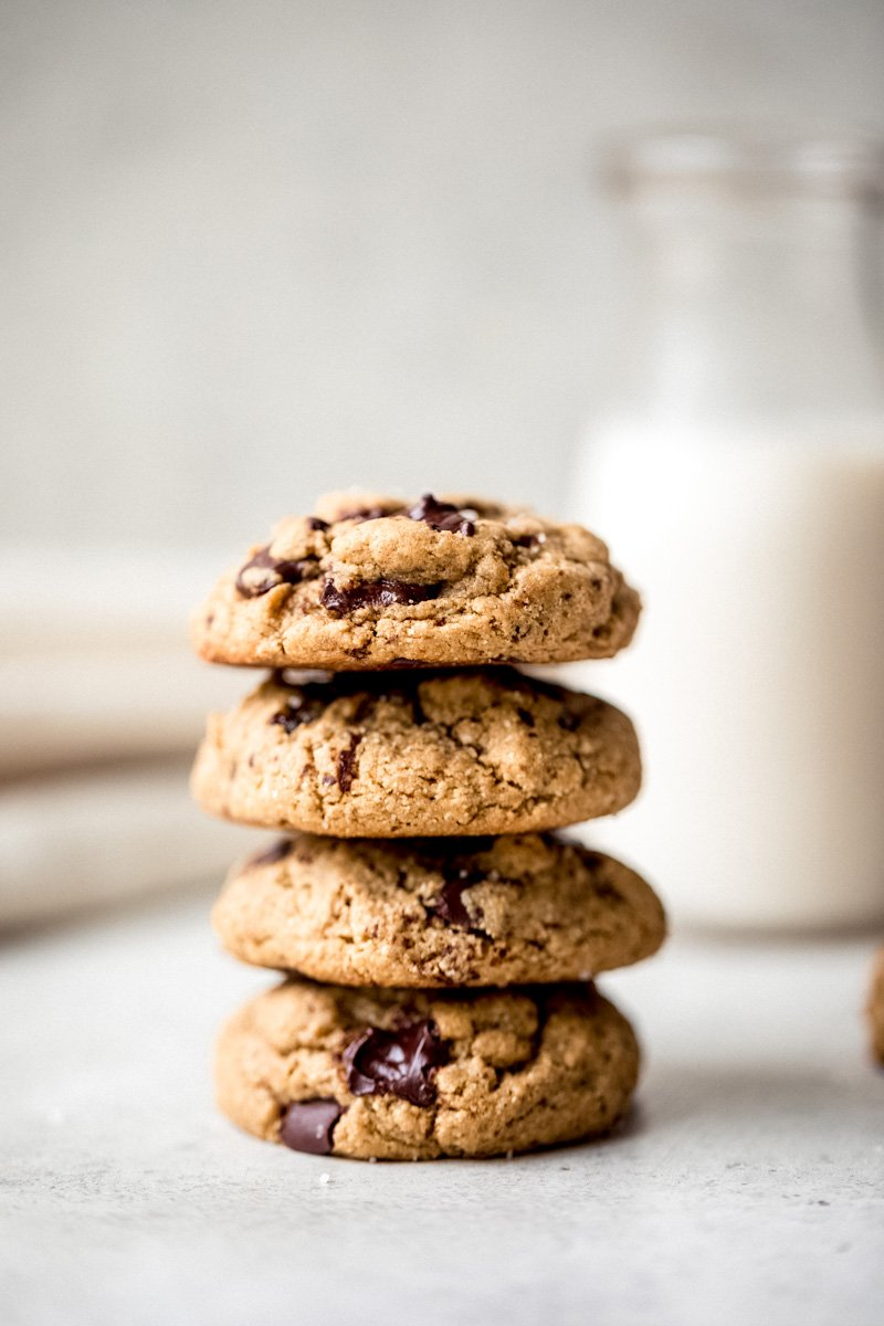 photo of stacked healthy gluten free peanut butter cookies with a glass of milk