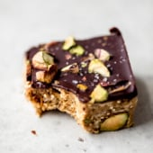 dark chocolate quinoa crunch bar with a bite taken out