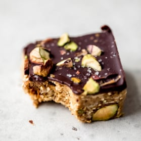 dark chocolate quinoa crunch bar with a bite taken out