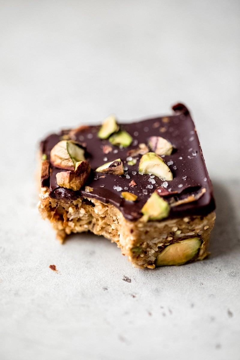 no bake dark chocolate quinoa crunch bar with a bite taken out