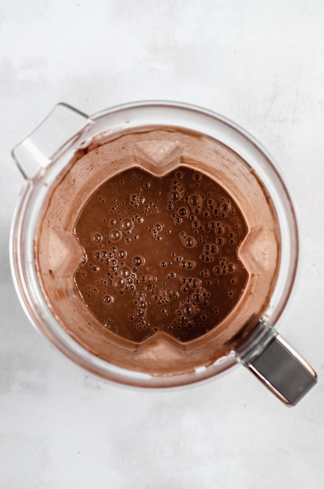 dairy free coconut chocolate zucchini smoothie in a blender