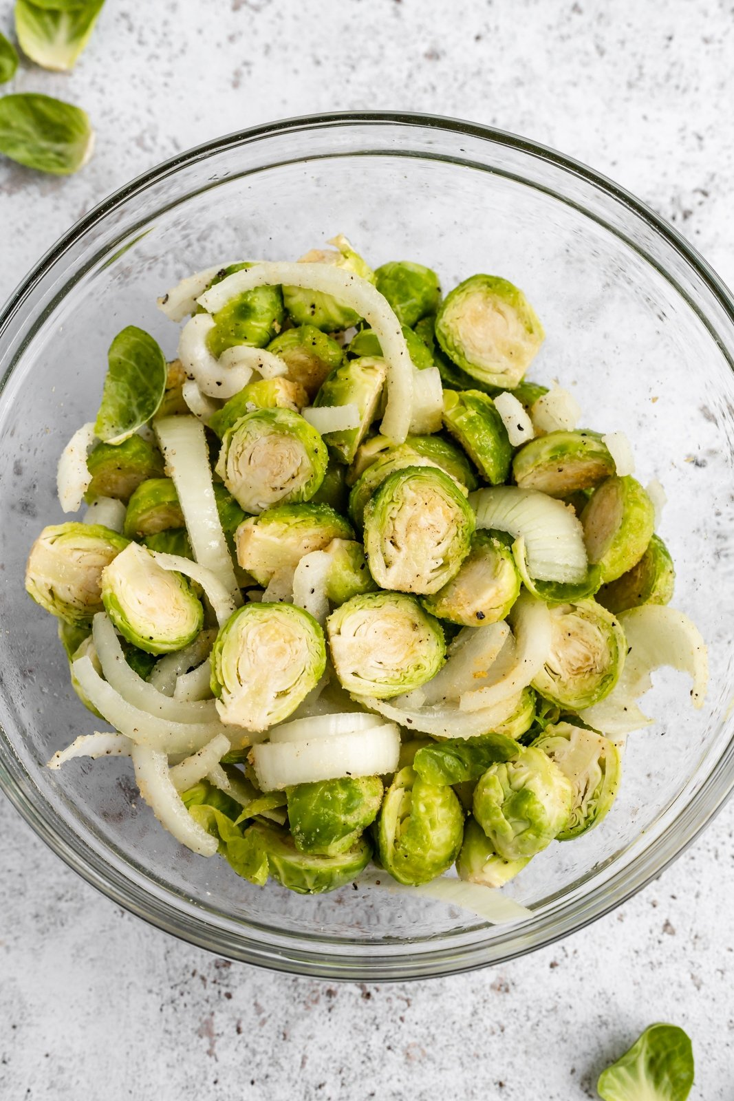 brussels sprouts and yellow onion in a bowl