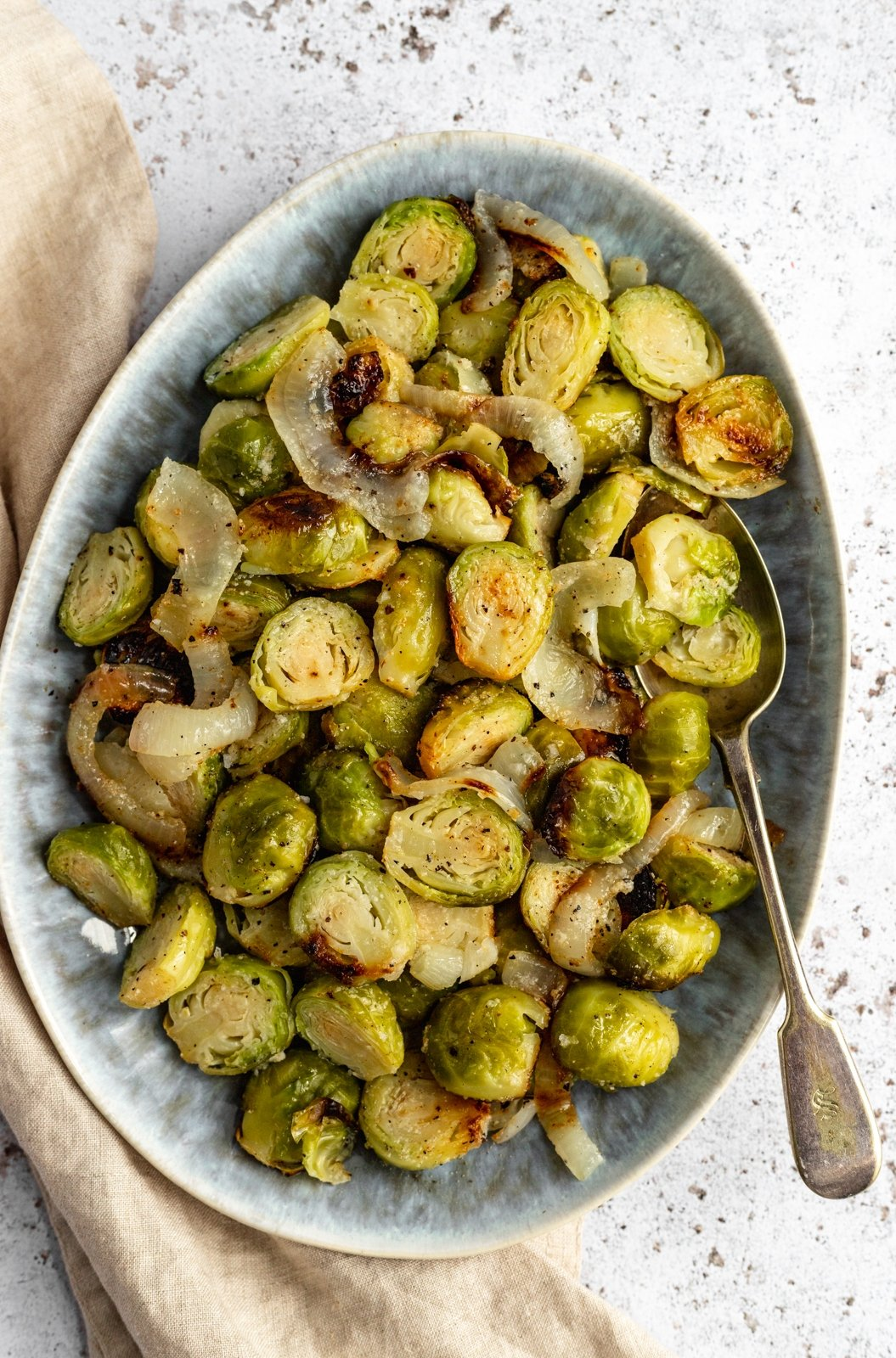 foil pack grilled brussels sprouts in a dish with a spoon