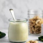 vegan cashew cream sauce in a jar with a spoon