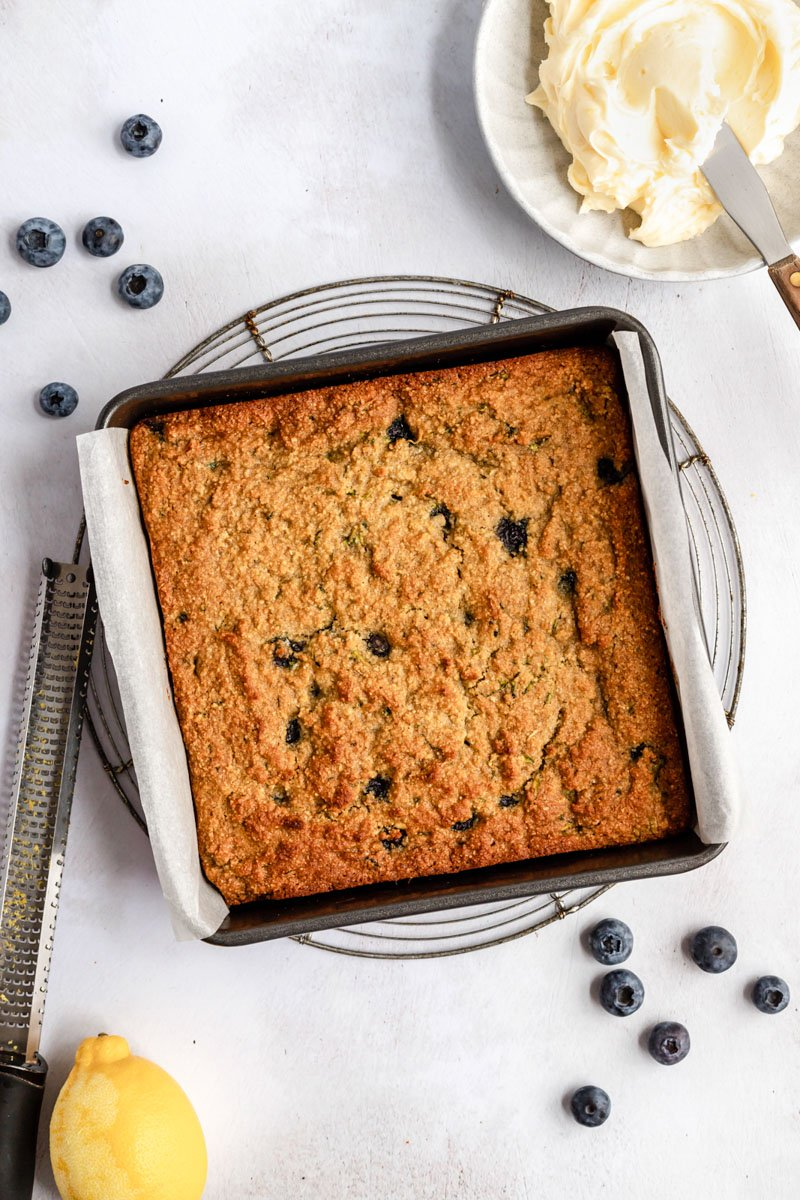 unfrosted healthy blueberry zucchini cake in a square pan