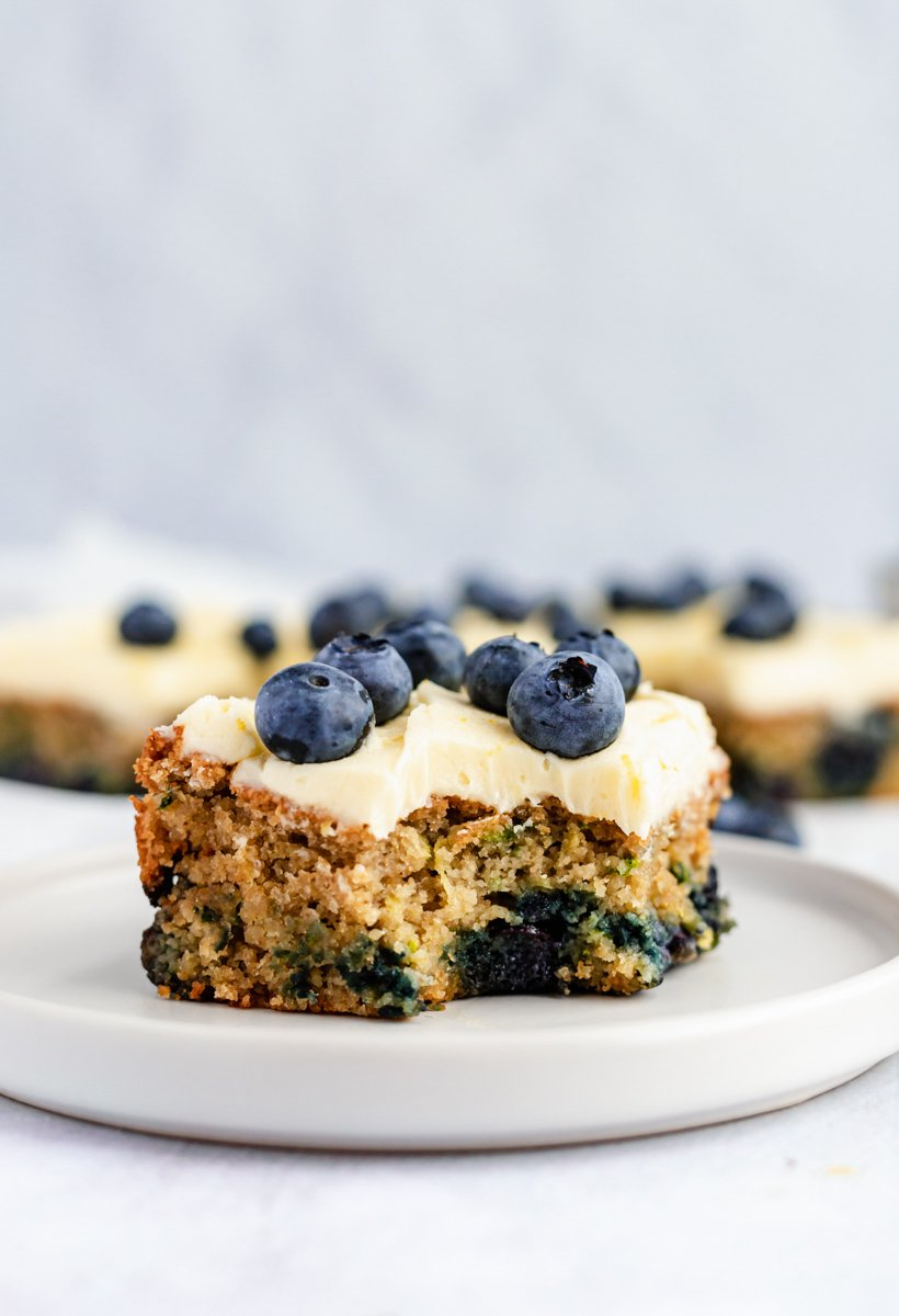 slice of gluten free lemon blueberry zucchini cake on a plate