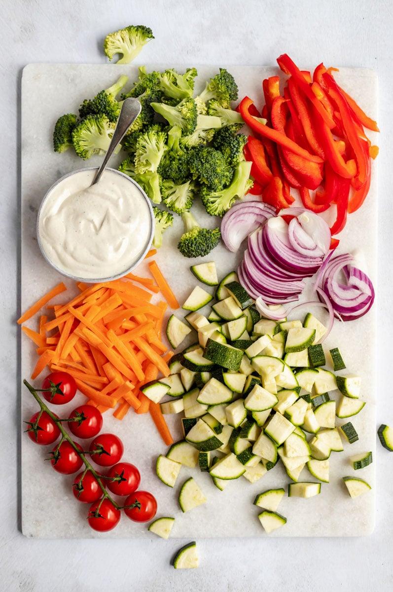 vegetables on a cutting board to make vegan pasta primavera