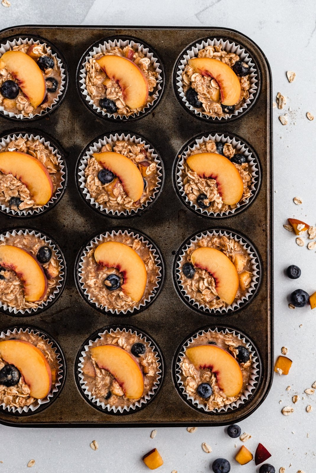 almond butter blueberry oatmeal cups in a muffin tin