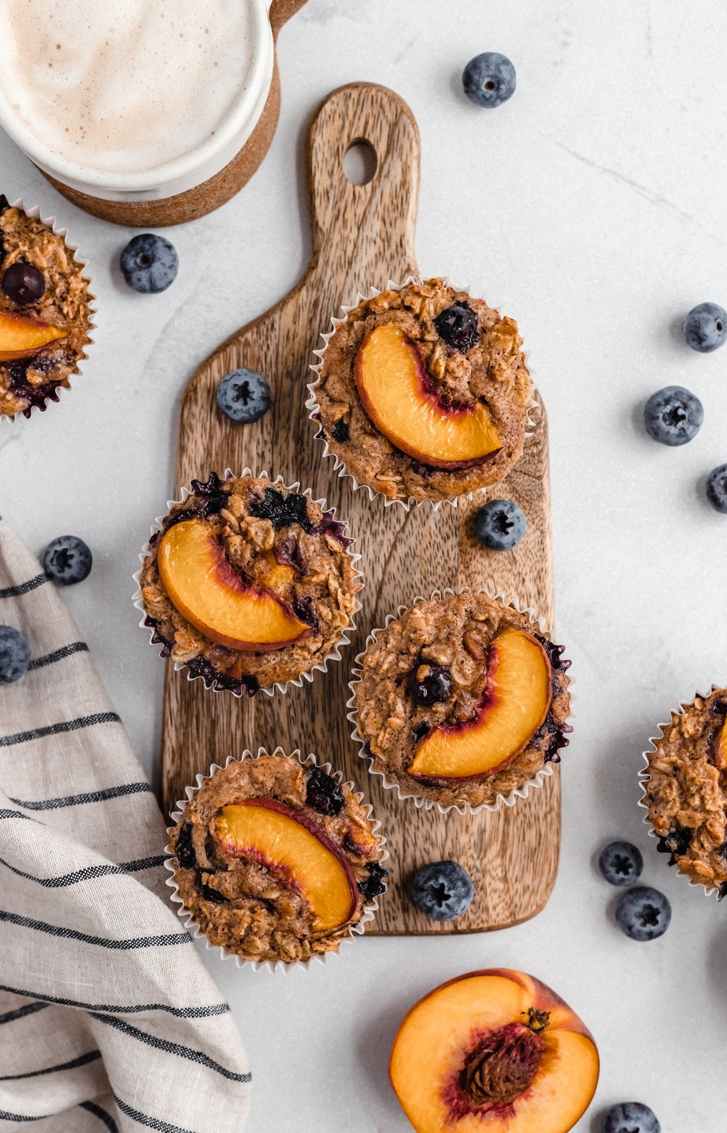 almond butter peach oatmeal cups on a wooden board