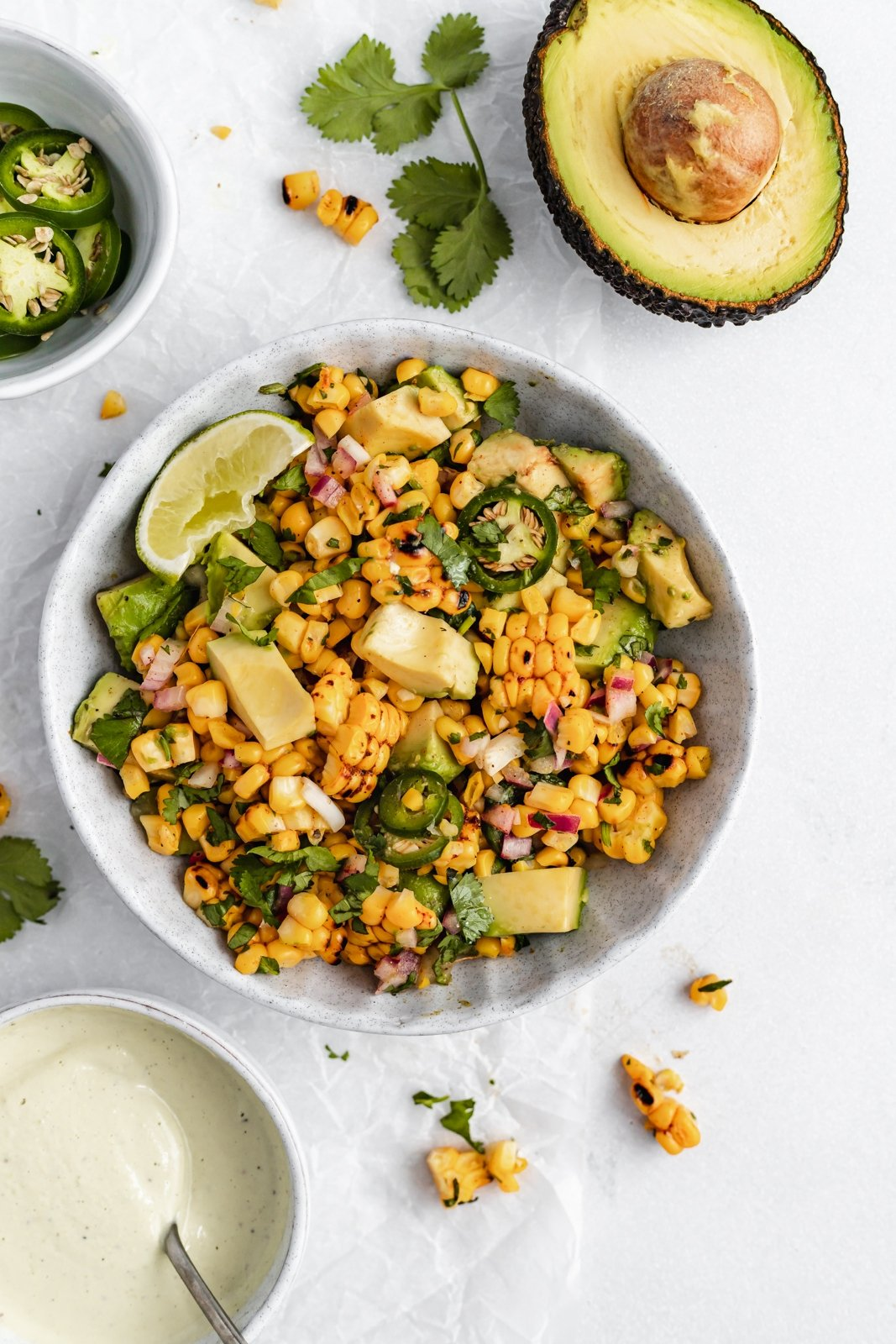 grilled street corn avocado salsa in a bowl