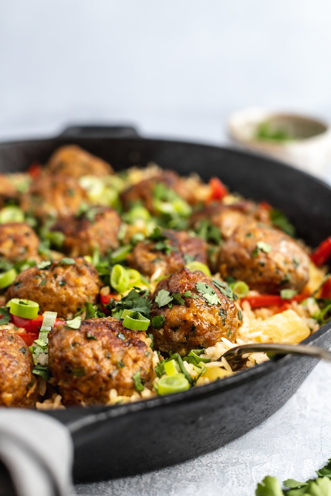 one pan firecracker chicken meatballs with rice in a pan
