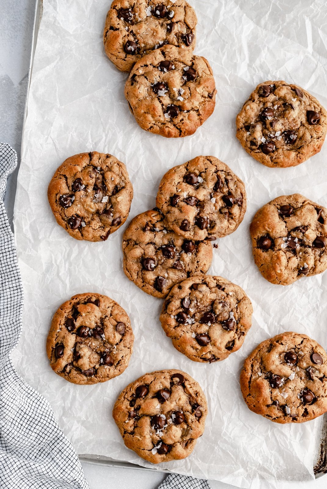 healthier flourless peanut butter oatmeal cookies on parchment paper