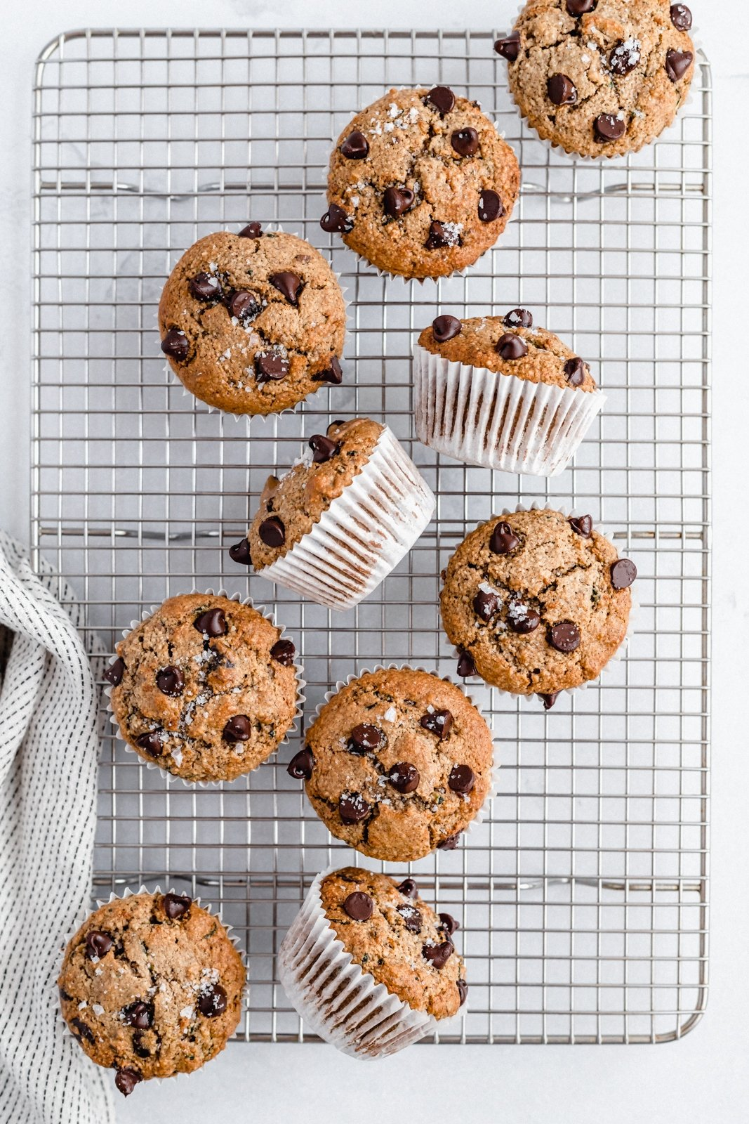 healthy chocolate chip zucchini muffins on a wire rack