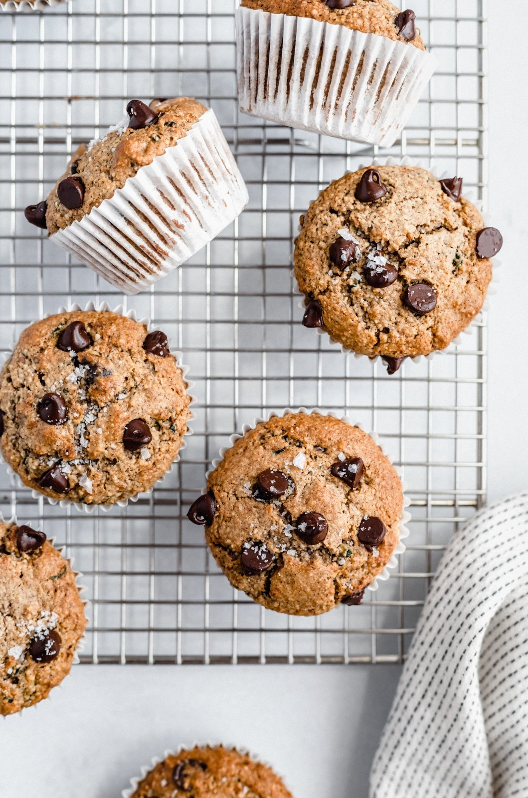 healthy zucchini chocolate chip muffins on a wire rack