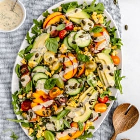 avocado peach tomato salad recipe on a platter