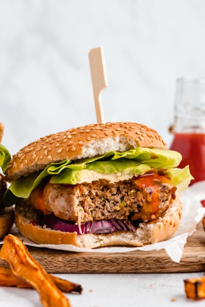 buffalo zucchini chicken burger with a bite taken out