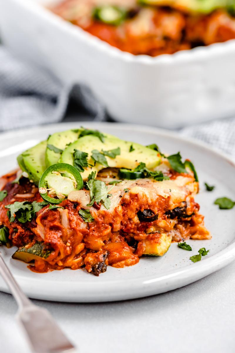 slice of vegetarian enchilada casserole on a plate