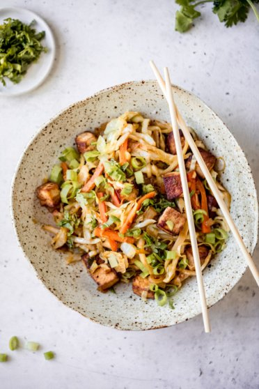 vegan egg roll in a bowl with chopsticks