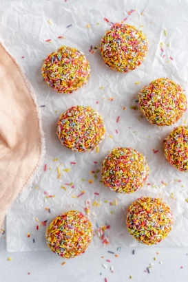 no bake birthday cake energy bites on parchment paper