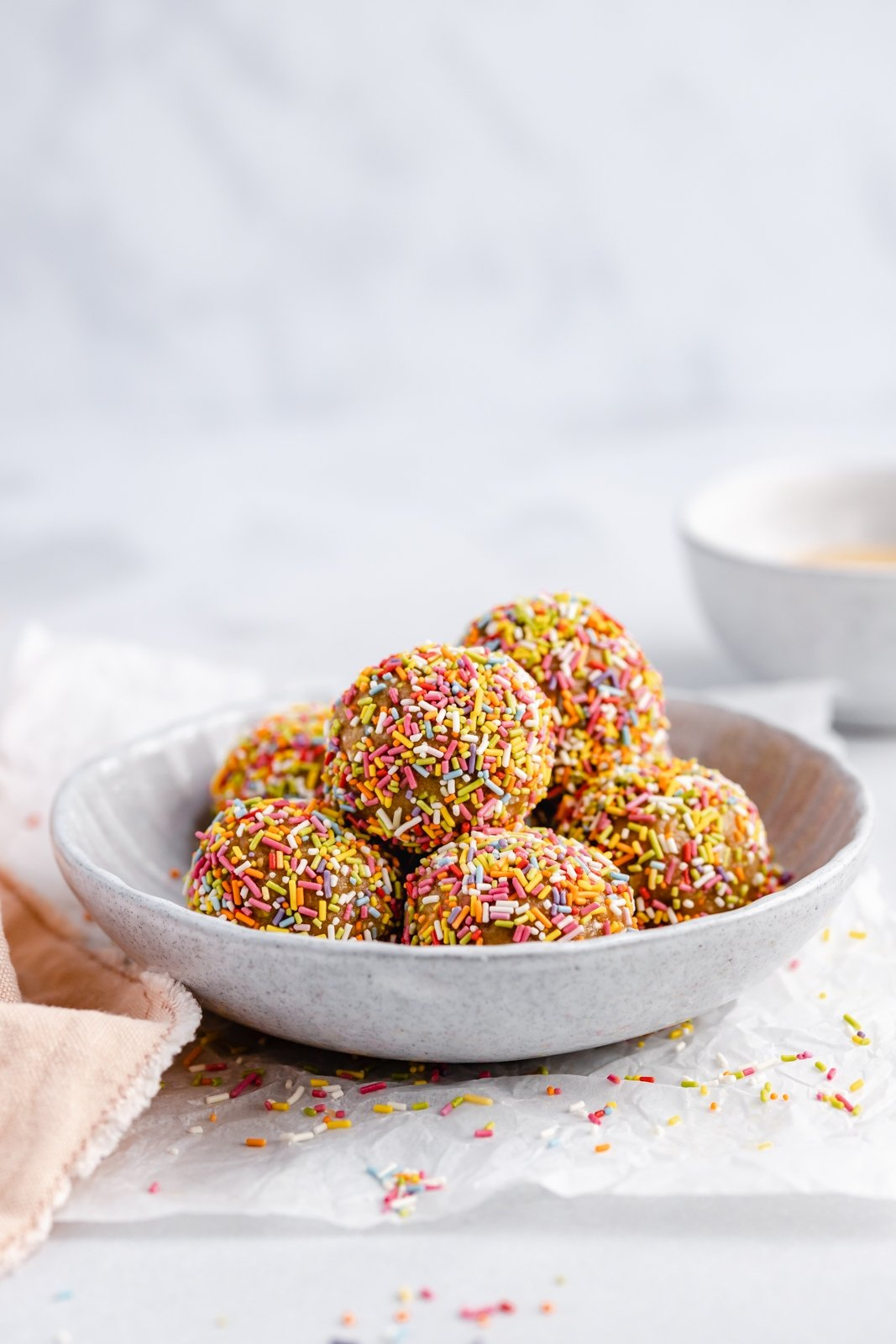 healthy birthday cake energy bites in a bowl