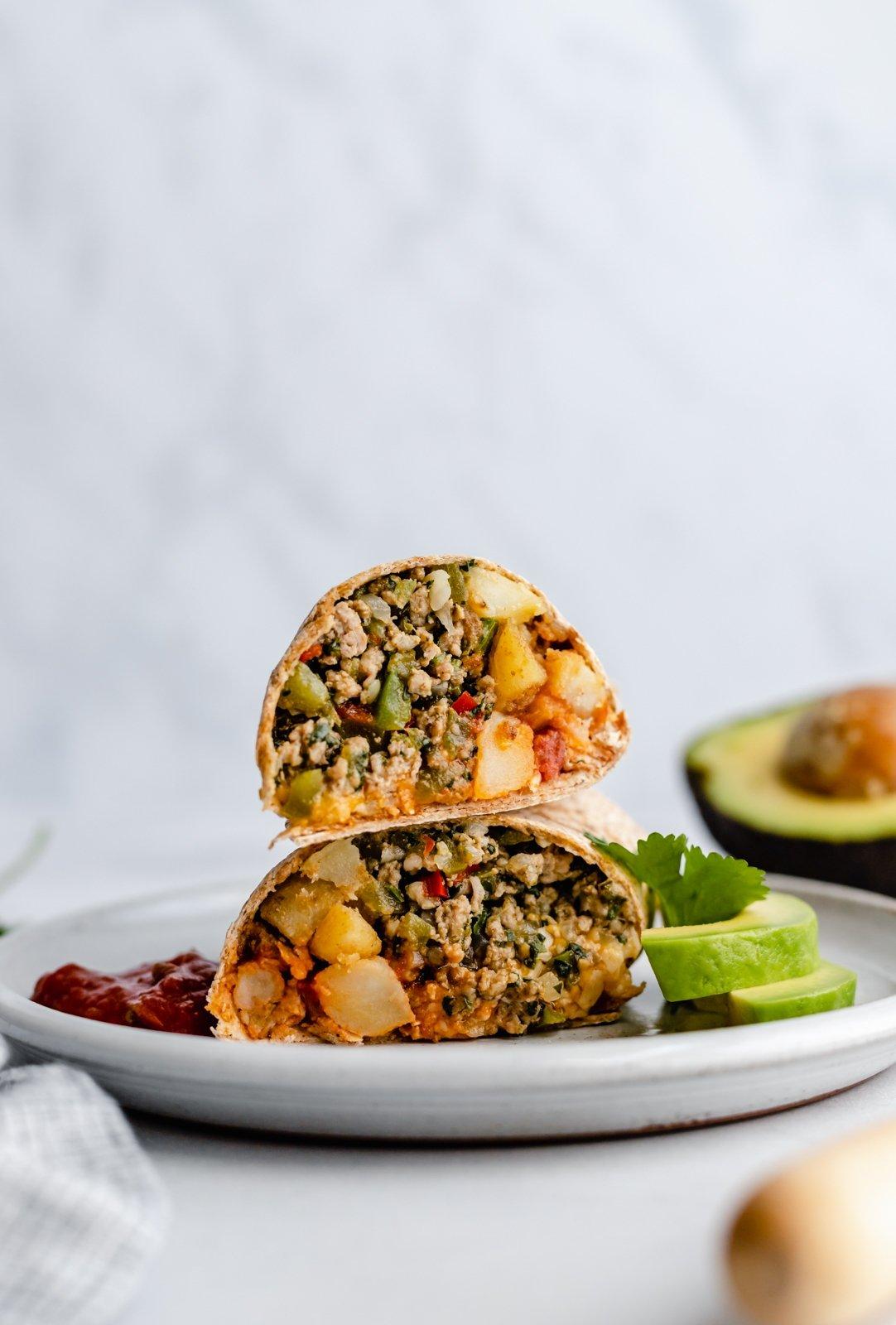 freezer-friendly green chile chicken burrito on a plate