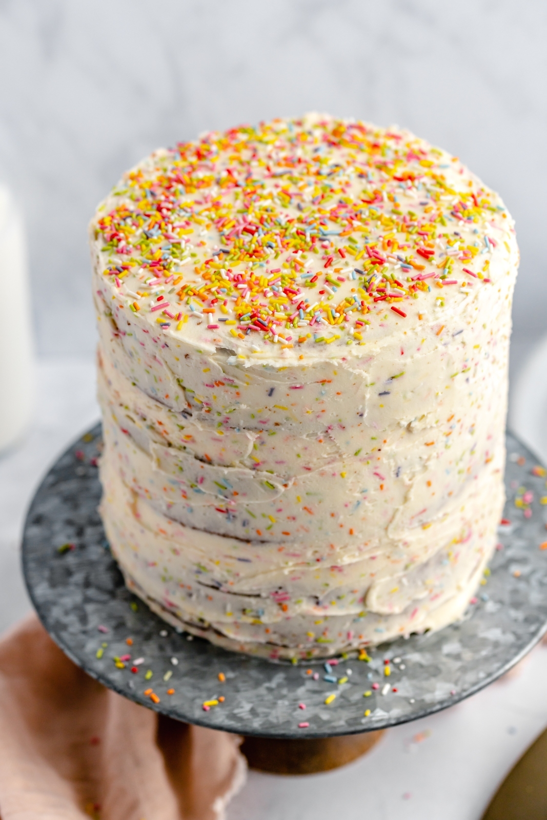 the best healthy birthday cake with sprinkles on a cake stand