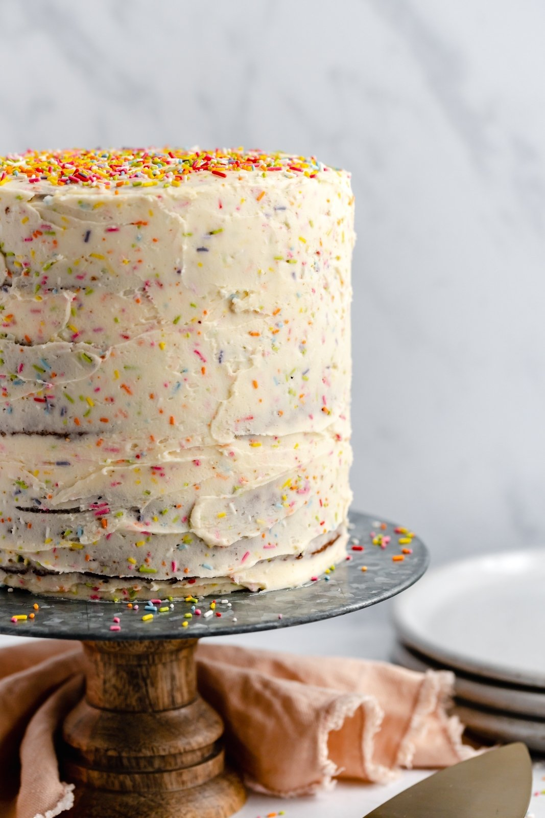 healthy birthday cake with sprinkles on a cake stand