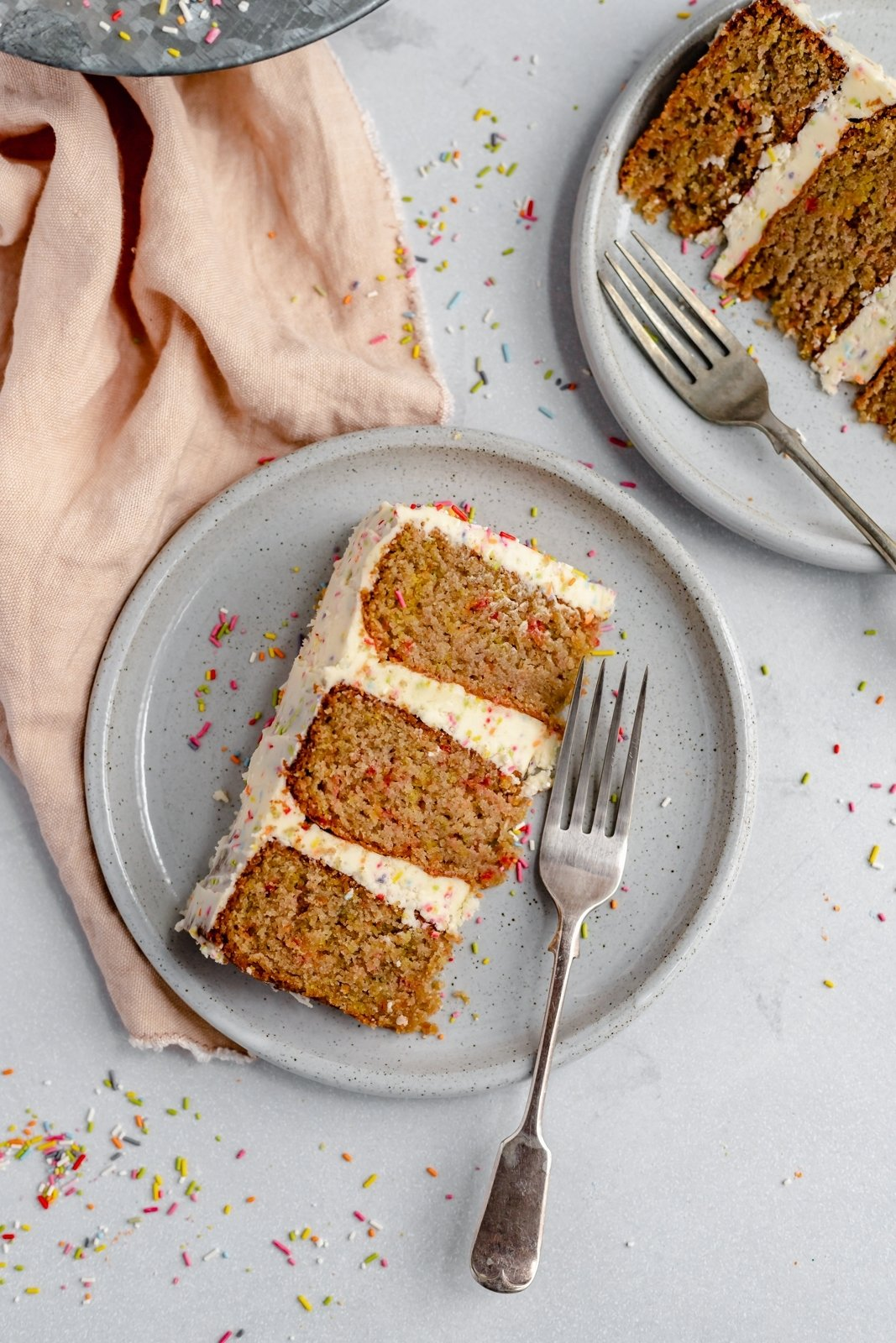 slice of homemade healthy birthday cake on a plate with a fork