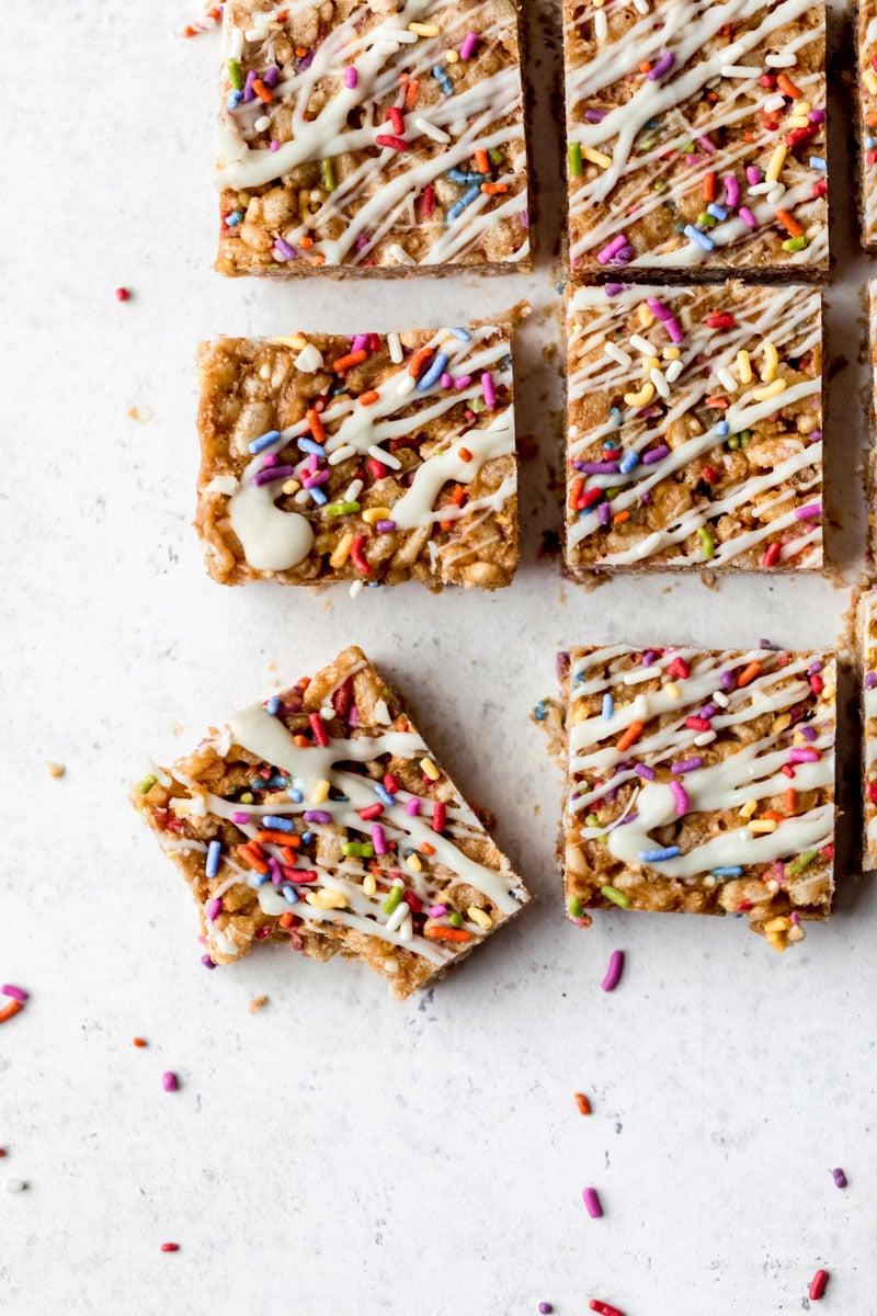 healthy birthday cake rice krispie treats on a grey board