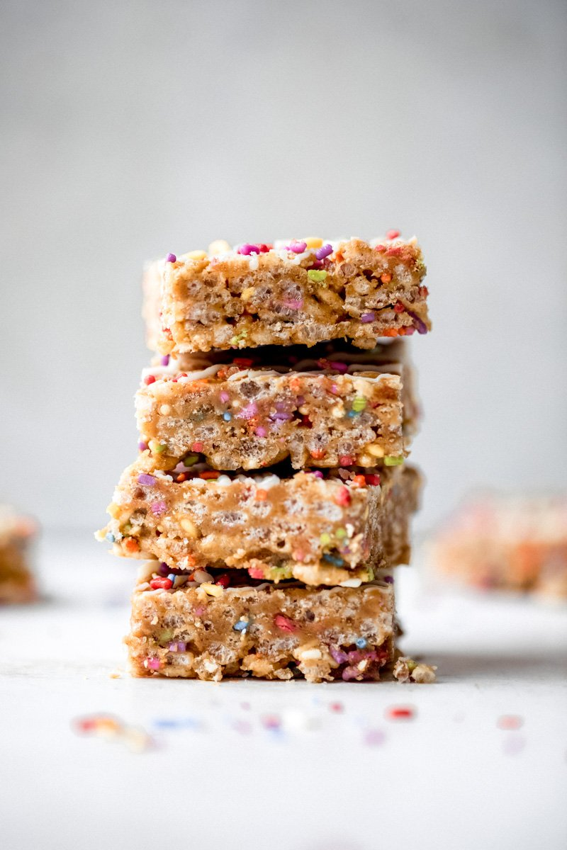 healthy birthday cake rice krispie treats in a stack