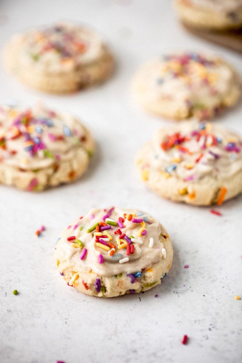 healthy birthday cake cookies on a grey board