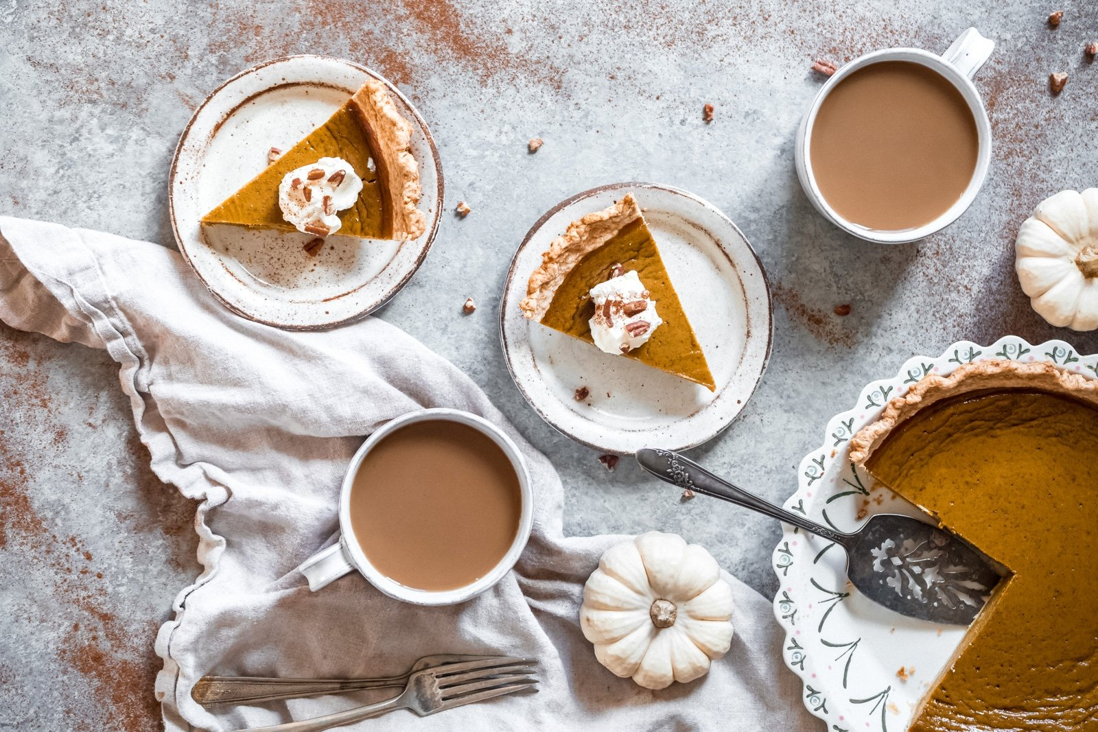 healthy pumpkin pie in a pie dish and on plates