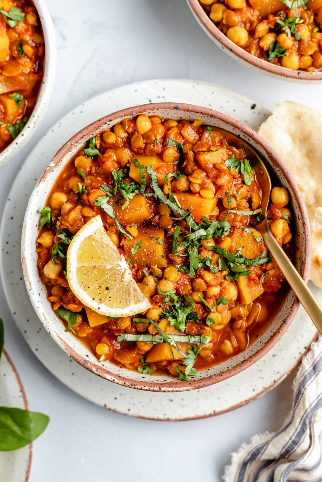 chickpea Moroccan stew in a bowl with a lemon wedge