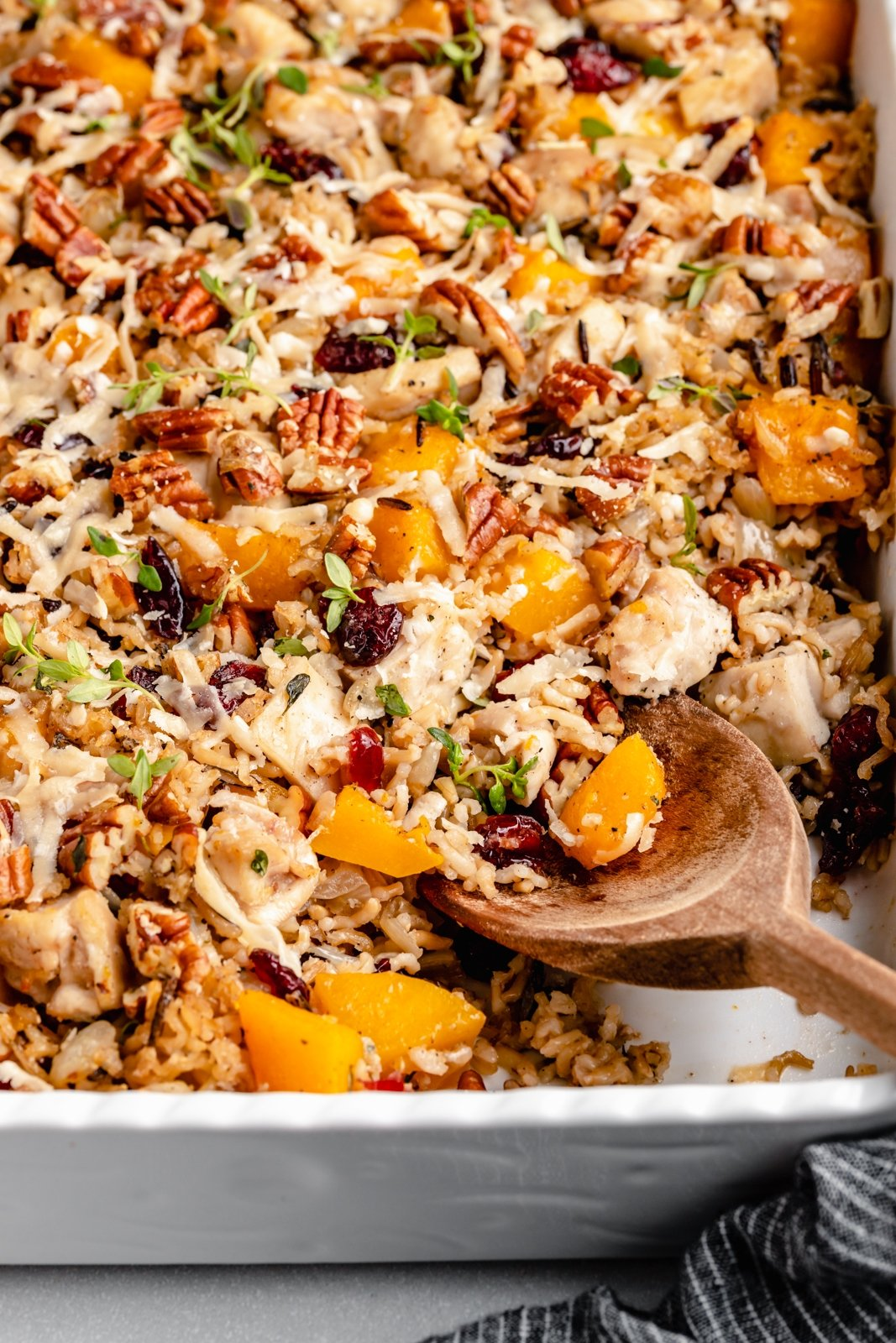 butternut squash chicken wild rice casserole in a dish with a spoon