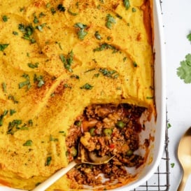 indian-inspired shepherd's pie in a baking dish with a spoon