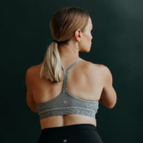back of a woman in a sports bra