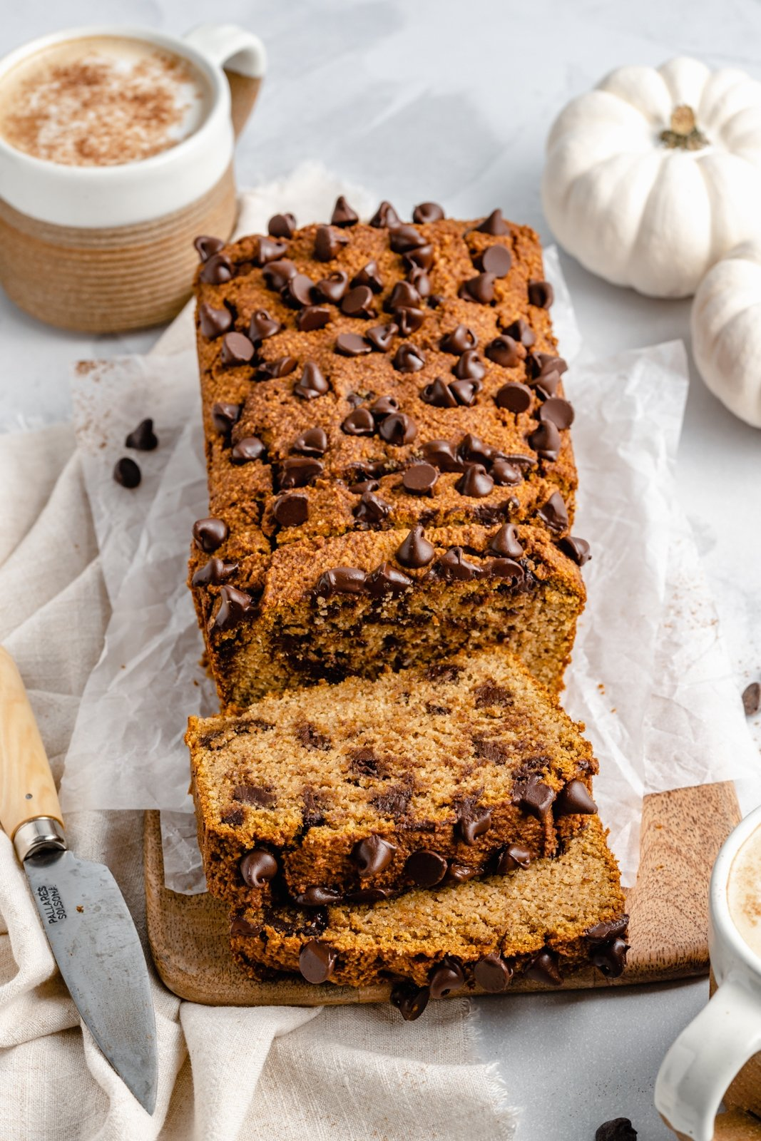 almond flour pumpkin bread with chocolate chips on a wooden board