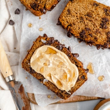 slice of almond flour pumpkin bread with butter and honey