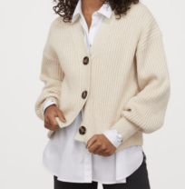 woman wearing a cream cardigan