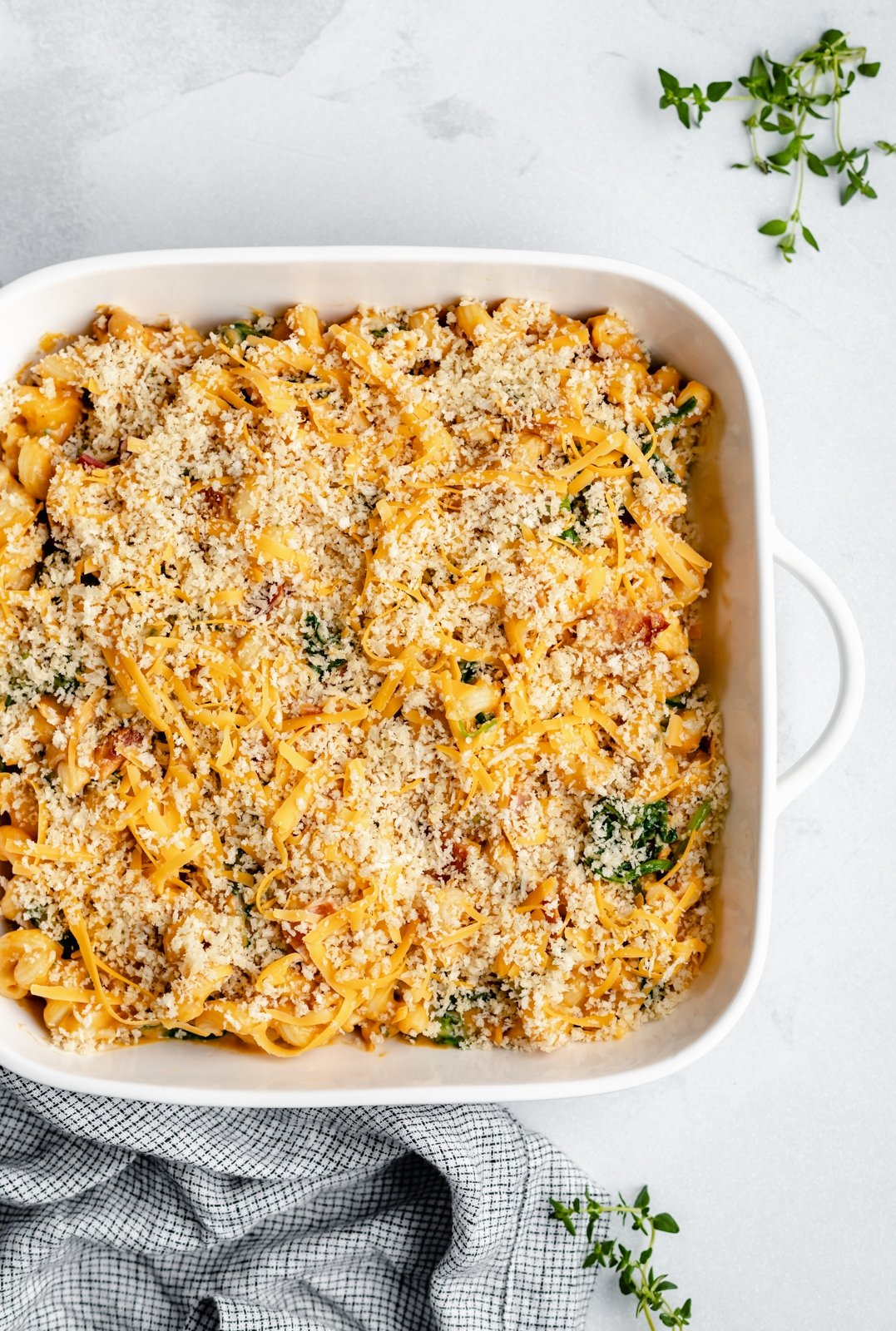 pumpkin mac and cheese bake in a square baking dish